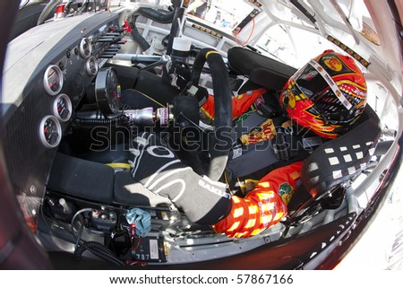 INDIANAPOLIS, IN - JULY 24:  Jamie McMurray straps into his Bass Pro Shops Chevrolet for the Brickyard 400 race at the Indianapolis Motor Speedway on July 24, 2010 in Indianapolis, IN. - stock photo