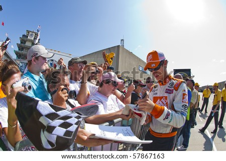 INDIANAPOLIS, IN - JULY 24:  Joey Logano signs a few autographs before the Brickyard 400 race at the Indianapolis Motor Speedway on July 24, 2010 in Indianapolis, IN. - stock photo