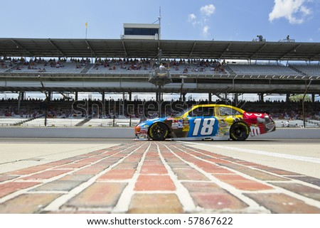 INDIANAPOLIS, IN - JULY 23:  Kyle Busch brings his M&M's Toyota across the bricks for the Brickyard 400 race at the Indianapolis Motor Speedway on July 23, 2010 in Indianapolis, IN. - stock photo