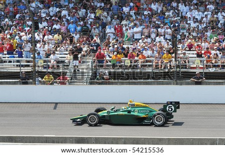INDIANAPOLIS, IN - MAY 30: Indy car driver Takuma Sato is running in the Indy 500 race May 30, 2010 in Indianapolis, IN - stock photo