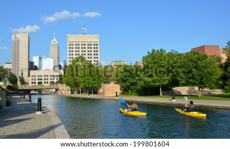 INDIANAPOLIS - JUNE 17:  Kayakers enjoy the Central Canal in downtown Indianapolis on June 17, 2014. The three mile loop is a popular walking and jogging downtown trail. - stock photo