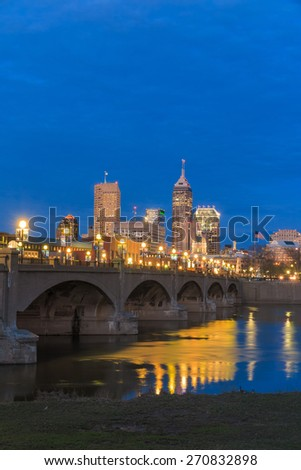 Indianapolis skyline and the White River at twilight - stock photo