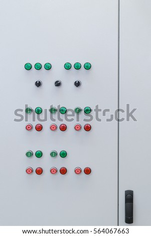 Indicator Lights Green And Red Color On A Gray Door Of The Electrical Cabinet Switches