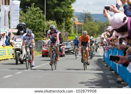 INDICATORE, AREZZO, ITALY - MAY 16: Cyclists at intermediate finish during the 11th stage of 2012 Giro d'Italia on May 16, 2012 in Indicatore, Arezzo, Italy