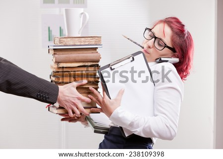indifferent man overloading colleague woman with work - stock photo