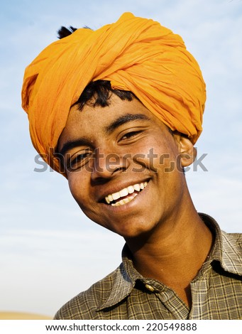 Indigenous Indian boy smiling at the camera. - stock photo