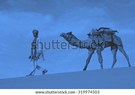 Indigenous Indian man walking desert camel Concept