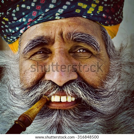 Indigenous Senior Indian Man Looking at the Camera Concept - stock photo