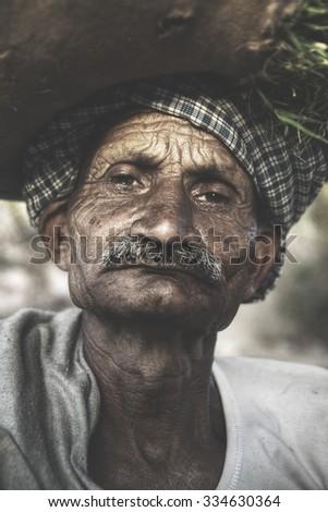 Indigenous Senior Indian Man Looking Grumpy At The Camera Concept - stock photo