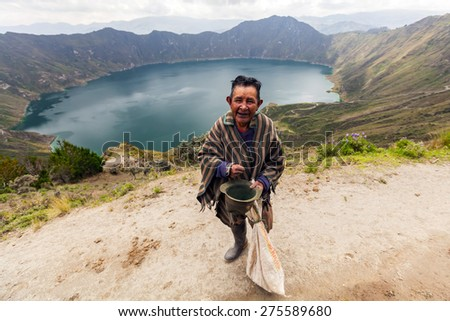Indigenous Villager Smiling At The Camera, Quilotoa, South America  - stock photo