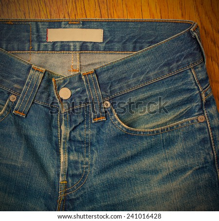 indigo jeans with a button, close-up photo, instagram image style - stock photo