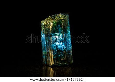 Indigolite mineral stone, black background - stock photo