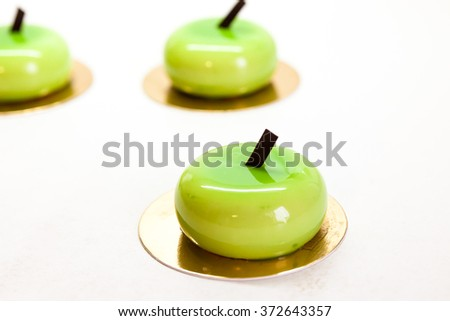 Individual cakes in a green glaze in the form of apples