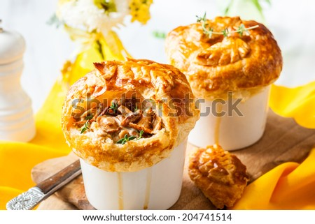Individual Mushroom pot pie with puff pastry crust - stock photo