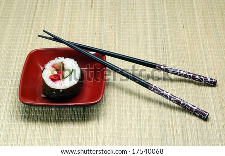 Individual Sushi in a square plate and hashi.