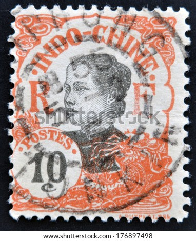 INDOCHINA - CIRCA 1907: A stamp printed in Indochina shows Annamite girl, circa 1907.