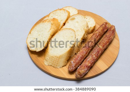 Indochina side dish bread with fermented pork sausage and chinese sausage - stock photo