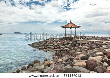 Indonesia, Bali, gazebo on the beach. Beautiful seascape - stock photo