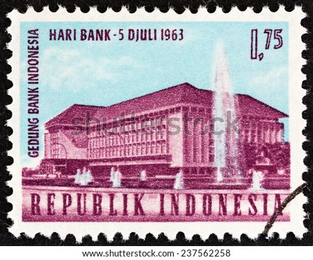 """INDONESIA - CIRCA 1963: A stamp printed in Indonesia from the """"National Banking Day """" issue shows Bank of Indonesia, Djakarta, circa 1963.  - stock photo"""