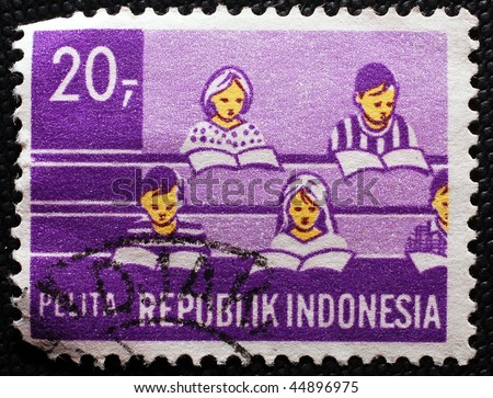 INDONESIA - CIRCA 1993: A stamp printed in Indonesia shows image of students reading in a class or lecture, circa 1993