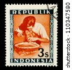 "INDONESIA-CIRCA 1948: A stamp printed in Indonesia shows Metalworkers, without inscription, from series ""Indonesian Vienna Issues"", circa 1948 - stock photo"