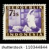 """INDONESIA-CIRCA 1947: A stamp printed in Indonesia shows Nurse with spelling """"Repoeblik"""", without inscription, from series """"Indonesian Vienna Issues"""", circa 1947 - stock photo"""
