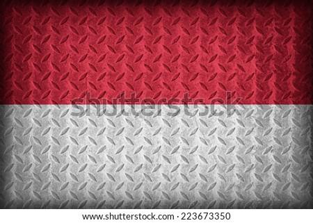 Indonesia flag pattern on the diamond metal plate texture ,vintage style - stock photo
