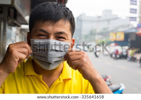 Indonesia palm oil fire cirsis Asian people using mask for protect respiratory systemcaused by the forest fire and burning of plantation in Indonesia