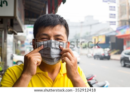 Indonesia palm oil fire cirsis Asian people using mask for protect respiratory systemcaused by the forest fire and burning of plantation in Indonesia - stock photo