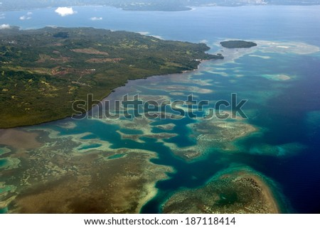 Indonesia tropical paradise crystal water turquoise aerial view from plane - stock photo