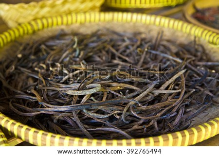Indonesian Condiments ,traditional condiments ,culture ,long black condiments,green  ,natural condiments ,vanilla basket ,vanilla on plate ,dry vanilla , vanilla on table ,vanilla tasty ,vanilla dry - stock photo