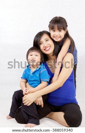 Indonesian Family On Blue Shirt - stock photo