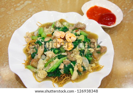 indonesian food named mie titi from makassar, fried noodle mixed with vegetable meat and seafood