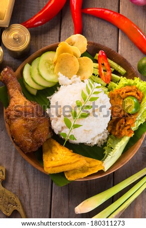 indonesian fried chicken rice on traditional background