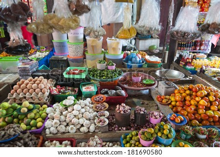 Indonesian Island Outdoor Market. Fresh fruits and vegetables are displayed in a traditional market on Banggai Island in Indonesia. - stock photo