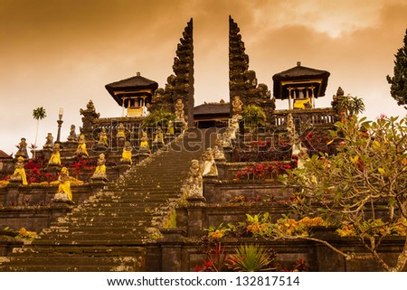 indonesian old temple pura Besakih on a cloudy sunset background. Bali. - stock photo