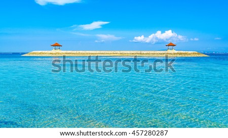 Indonesian style beach pergola built on a man made island just off the beach.