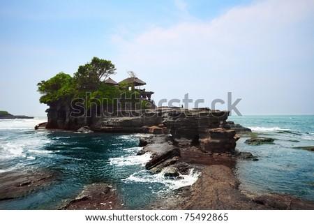 Indonesian temple in sea. Tanah lot complex. Bali. Indonesia - stock photo