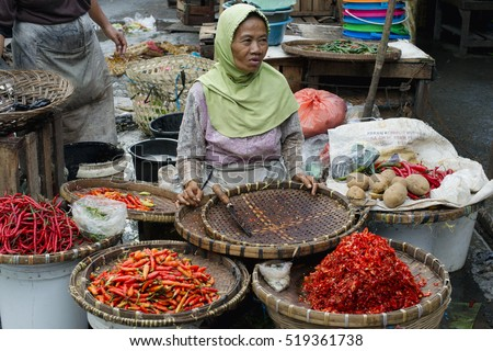 Indonesian woman selling variety of chili peppers at the market in Semarang. January 9, 2014 - Java, Indonesia