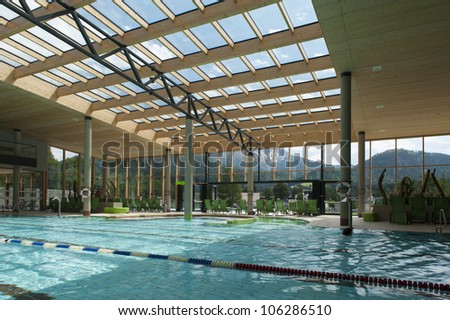 indoor architecture of public swim bath with laps and glass roof - stock photo