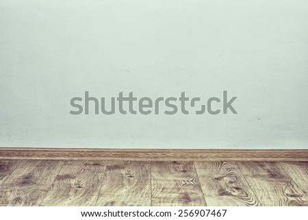 Indoor background with oak parquet and wall