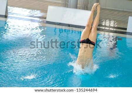 Indoor diving in a pool with negative space for text