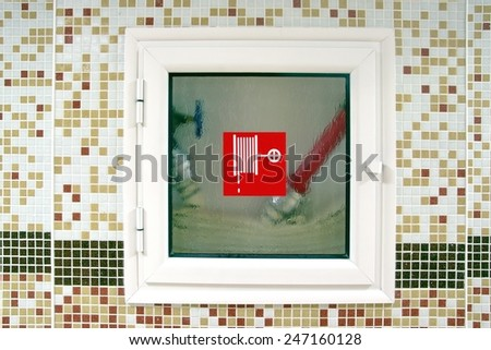 Indoor Fire Hydrant Cabinet with Water Hoses. - stock photo
