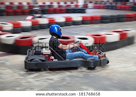 Indoor karting race (kart and safety barriers) - stock photo