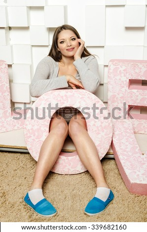 """Indoor phoro of beautiful woman with big letter """"O"""" - stock photo"""