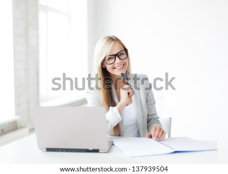indoor picture of smiling woman with documents and pen - stock photo