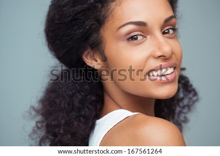 Indoor portrait of a beautiful smiling African woman.