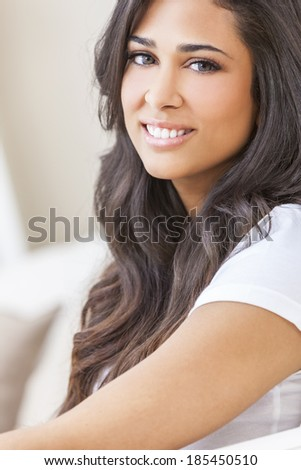 Indoor portrait of a beautiful young Latina Hispanic woman smiling