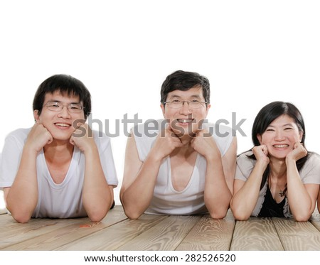 Indoor portrait of asian family lying on  - stock photo