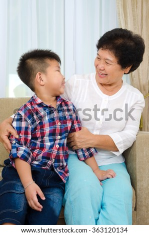 Indoor portrait of asian senior woman and grandchild - stock photo
